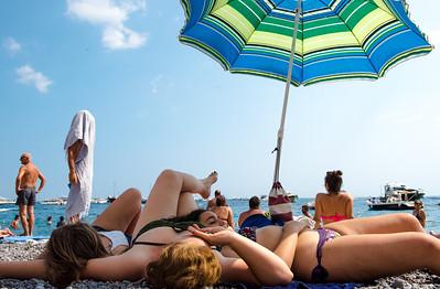 Sun bathers, Poisitano, Italy
