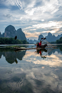 Cormorant fisherman relaxing  on the Li River, China