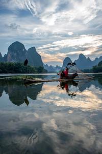 Cormorant fisherman relaxing  on the Li River, China