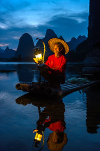 Nightime fisherman, Li River, China