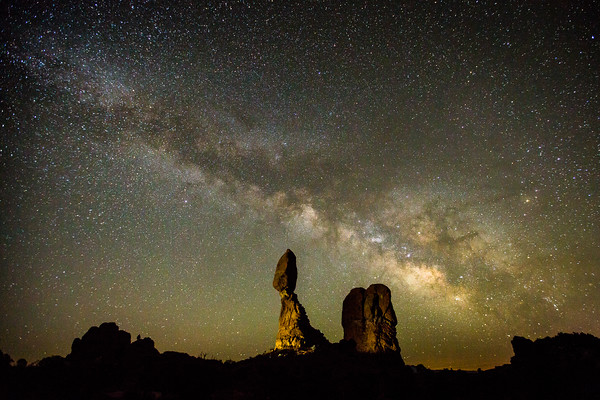 View of the Milky Way above Balanced Rock in Arches National Park, outside Moab, Utah