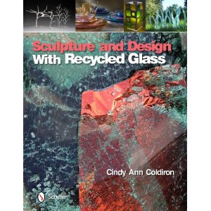 "My work is featured in this full color coffee table type book in which forty artists take the raw material of recycled glass and transform it into an astonishingly creative medium for sculpture and design. This ""green"" book is packed with photos of original recycled glass craft and sculpture representing emerging and established artists from Swaziland to Australia to Canada and the United States, as well as photos of three public art sculptures that tell a story from design to construction to the final installation. This book also provides an overview of the technical issues in working with recycled glass and step-by-step instructions on creating four glass craft and sculpture projects. Also included is an overview of trend setting green companies who are using recycled glass in interior design and decorative and utilitarian products such as tiles, countertops, and drinking vessels. This is a great resource for interior designers, ""green"" or LEED professionals, homeowners, museums, galleries, art collectors, art educators, artists, and individuals seeking to start a ""green"" glass business."