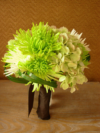 Hand tied bouquet of antique hydrangea, green & white spider chrysanthemums and lily grass wraps