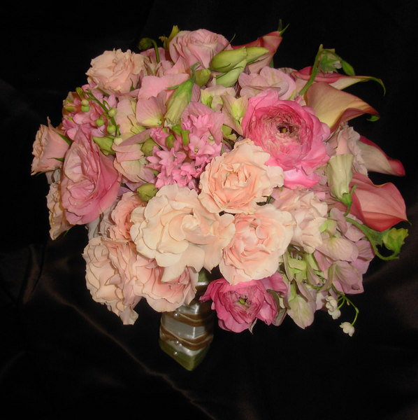 portrait bouquet of pink hyacinth, pink majolika spray roses, pink ranunculus, white sweet peas, pink mini calla lilies, pink/green hydrangea, pink lisianthus and lilies of the valley