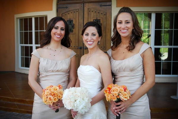 Photo by Studio 563....Hand tied bridal bouquet of white peonies, vandela roses & mini calla lilies....Bridesmaid's bouquets of macarena spray roses, orange unique roses and orange tulips. This wedding was featured in the Dec08 Houston Brides Magazine!