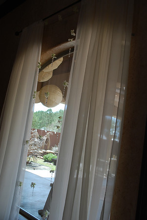 Our new ivory chiffon drapes replaced traditional tapestry on the windows! What a big difference with these orchid & crystal strands!