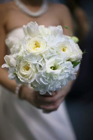 bridal bouquet consisted of white hydrangeas, garden roses, tulips, mini callas and lisianthus