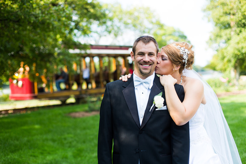 Wedding portraits at St. Anthony's of Padua Parish, Tinker Swiss Cottage,  and outside Nicholas Conservatory and Gardens. Wedding photographer – Ryan Davis Photography – Rockford, Illinois.