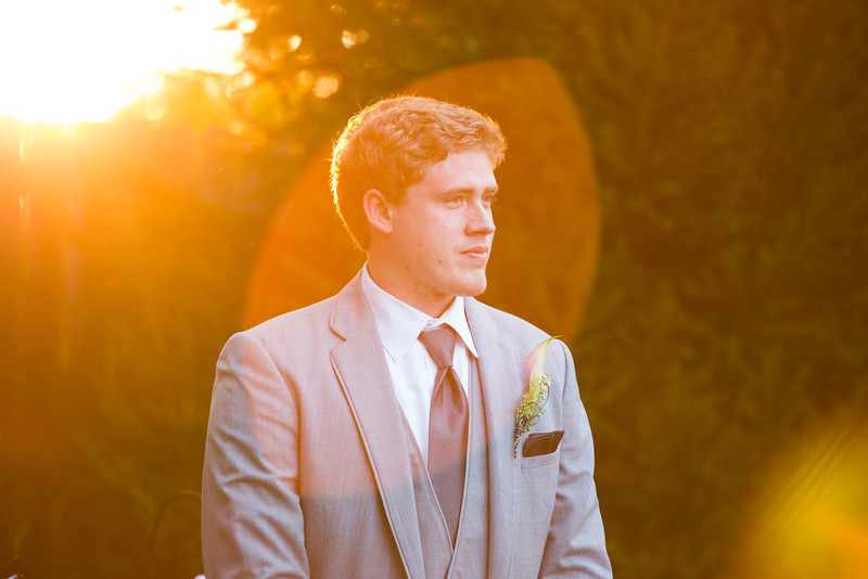Summer outdoor wedding ceremony at dusk at Williams Tree Farm in Rockton, IL. Wedding photographer – Ryan Davis Photography – Rockford, Illinois.