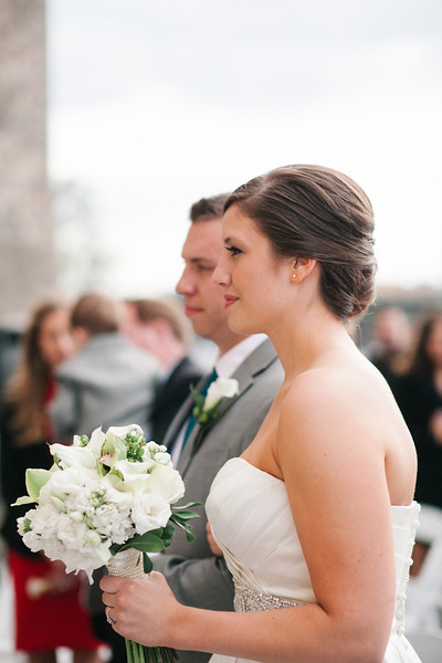 Spring outdoor wedding ceremony on the dock at Prairie St. Brewhouse on the Rock River.  Wedding photographer – Ryan Davis Photography – Rockford, Illinois.