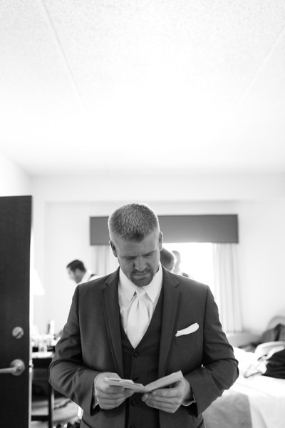 Preparations and pre-ceremony photography at Grand Harbor Resort for a wedding at Dubuque Arboretum and Botanical Gardens in Dubuque, Iowa. Wedding photographer – Ryan Davis Photography – Rockford, Illinois.