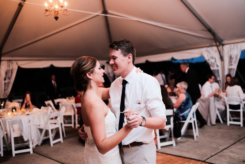 Morgan & John's fun outdoor tent reception on Point Patio at Eagle Ridge Resort near Galena, IL– Wedding photographer; Ryan Davis Photography – Rockford, Illinois.