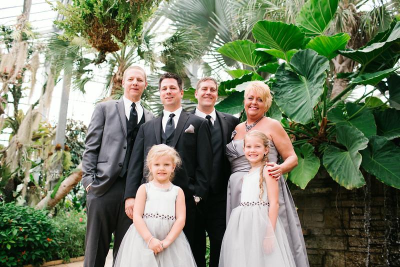 Pre-Ceremony portraits at Nicholas Conseravtory, Sinnissipi park, and preparations at Unitarian Universalist church before a gay wedding ceremony. Wedding photographer – Ryan Davis Photography – Rockford, Illinois.