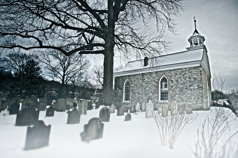 Legend of Sleepy Hollow Setting: Old Dutch Church of Sleepy Hollow and Burying Ground, c. 1685, in the Snow. Sleepy Hollow, Tarrytown, Westchester County, New York