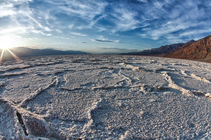 Taken at sunset. Badwater is a salt flat that is beneath the face of the Black Mountains that contains the lowest elevation in North America at 86 meters (282 ft) below sea level. (It is often mistakenly described as the lowest elevation in the Western Hemisphere, but that is actually Laguna del Carbón in Argentina at −105 meters (−344 feet)). The massive expanse of white is made up of almost pure table salt.