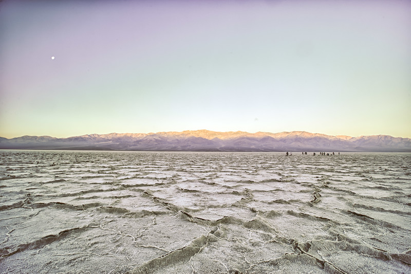Badwater. We went back the next morning to shoot in a different kind of light. Sunrise light hitting the distant mountains. The black dots on the salt in the distance are photographers.