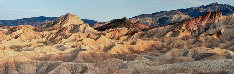 In the afternoon we climbed Zabriskie Point. From the top the mountains give off the glorious color. Its erosional landscape is composed of sediments from Furnace Creek Lake, which dried up 5 million years ago — long before Death Valley came into existence.