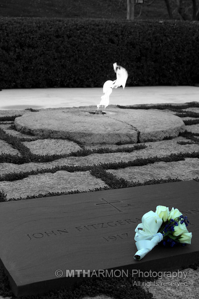 Eternal flame over grave of President John F. Kennedy at Arlington National Cemetery.  (Arlington, VA)