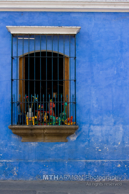 Wooden toys in a window.  (Antigua, Guatemala)