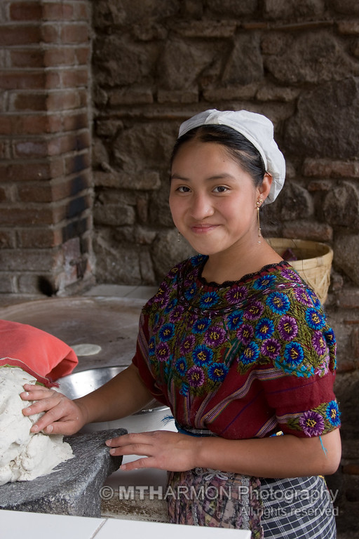 A girl making tortillas in Antigua, Guatemala.
