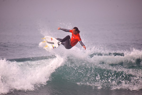 Jordy Smith getting air at The Hurley Pro Trestles 2013