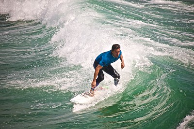 Kalani Robb taking a wave at APSS 2013.