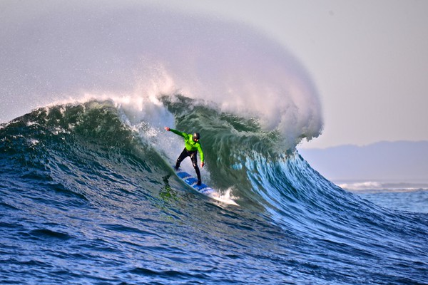 Big Wave World Record Holder Shawn Dollar taking a wave at Mavericks.
