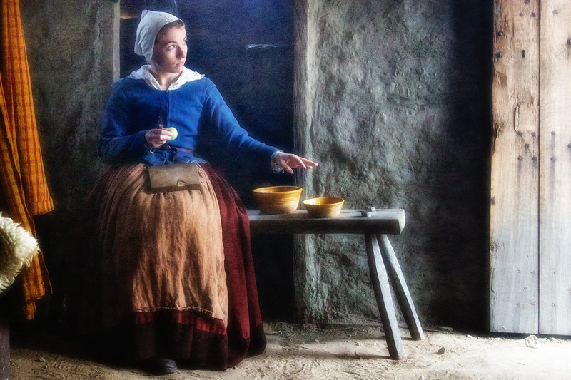 Life in Plymouth Colony: Costumed Female Pilgrim Interpreter Peeling Apples, 1627 English Village, Plimoth Plantation, Plymouth, Massachusetts