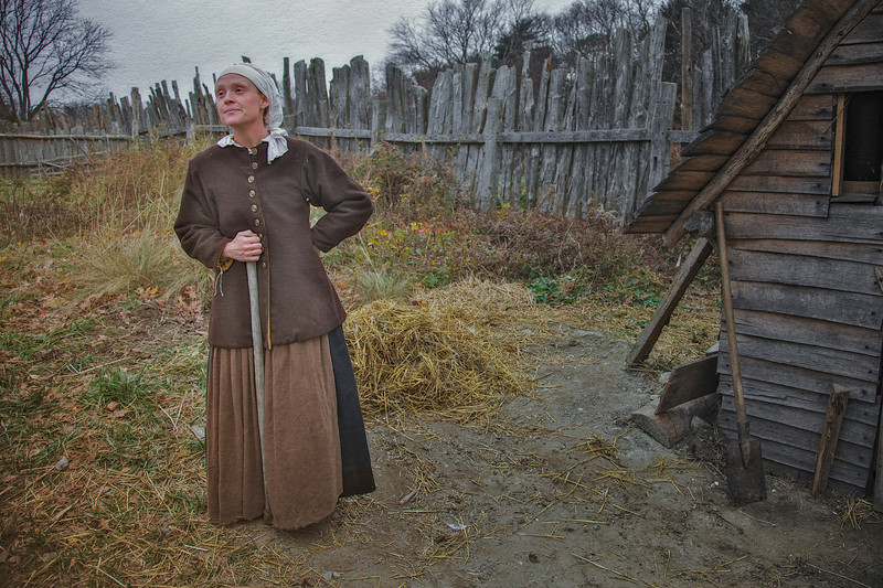 Life in Plymouth Colony: Costumed Female Pilgrim Interpreter in the Garden, 1627 English Village, Plimoth Plantation, Plymouth, Massachusetts