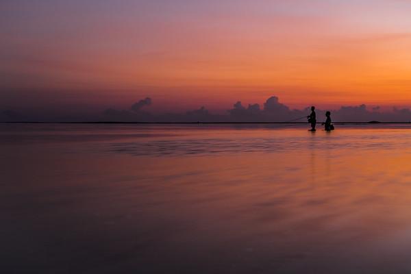 Sunset fishing at Nusa Dua Beach in Bali.