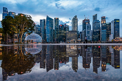 Reflection of Singapore's Marina Bay skyline.