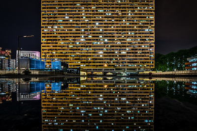 Reflection of People's Park Complex at night.