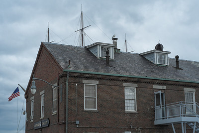 20120730.   Shipyard Galley museum building in Charlestown Navy Yard.  U.S.S Constitution masts and flag in background.