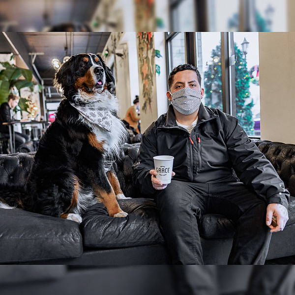 Service dog Pablo and co-owner Carlos Falcon at Middleton's Grace Coffee Co.