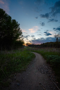 late sunset on a mountain bike trail in the city