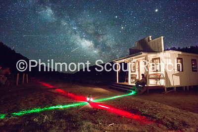 The Milky Way rests in the sky as crews return from Metcalf's campfire program on June 28th. Grayson Wolf rests on the porch of the cabin after a fantastic campfire that ran extra late because of audience participation.   Clay Helfrick | PhilNews