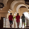 It's clear from other photos that I love the shapes and light on this walkway in the lobby of our hotel, so I asked these three on our first day to take a walk for me.