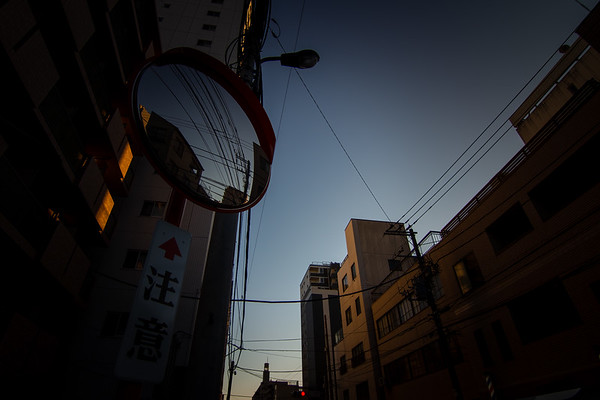 Dark Evening Shot of an Intersection Mirror in Tokyo (Translation of Sign: Caution)