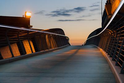 2012903.  Foot bridge over train tracks adjacent to Leonard Zakim Bunker Hill Memorial Bridge.  Boston MA.