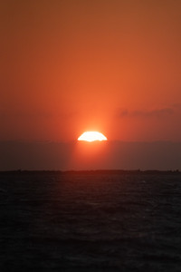 cloudy and fiery sunset over the ocean