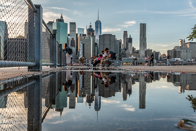 Reflection of lower Manhattan skyline