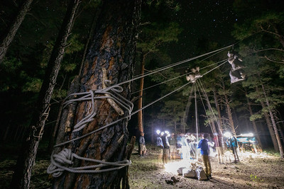 Crews 708-I-01 and I-02 hoist up their oops bear bag in the dark at Line Trail Camp on Friday, July 9th, 2021.
