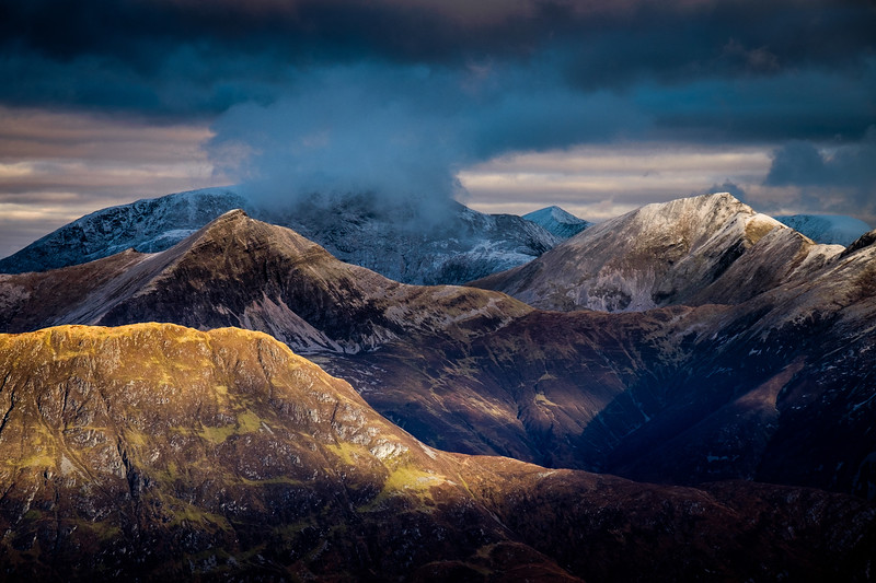 The ridges of the Mamores, backed by a cloud-capped Ben Nevis.
