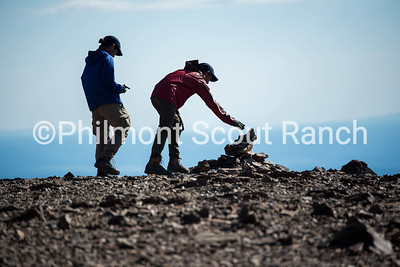 Tokinosuke Suzuki and Hinata Ito place a rock on the pile at the top of Baldy Mountain to commend their summit.
