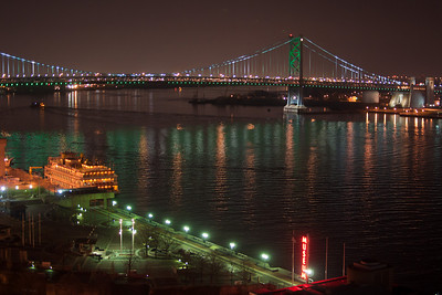 Philadelphia Belle riverboat at Penn's Landing with Benjamin Franklin Bridge.