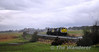 075 shatters the silence of the Curragh as it powers past hauling 076 back to Inchicore for repairs.  Sat 02.04.11