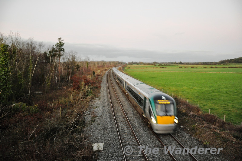 New ICR Sets 22047 + 22050 whiz past Straboe Bridge, between Portarlington and Portlaoise with the 1555 Heuston - Cork Shakedown Trial. This trial operates in advance of the 1600 Heuston - Cork to the end of the 3rd road in the Gullet and is then overtaken by the 1600. Mon 09.01.12