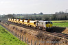 """080 is captured at Rosskelton bringing a rake of Autoballaster Wagons from Limerick to North Wall. After reloading at the Stone Bank in North Wall they were then due to head out the MGWR Sligo Line to Enfield. Wed 01.02.12<br /> <br /> Rail Scene Ireland also photographed this train passing Drumcondra in Dublin later that afternoon: <a href=""""http://smu.gs/yB6Lux"""">http://smu.gs/yB6Lux</a>"""