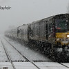 209 charges through the snow at Moira with the 1320 Connolly/Belfast Central 210113