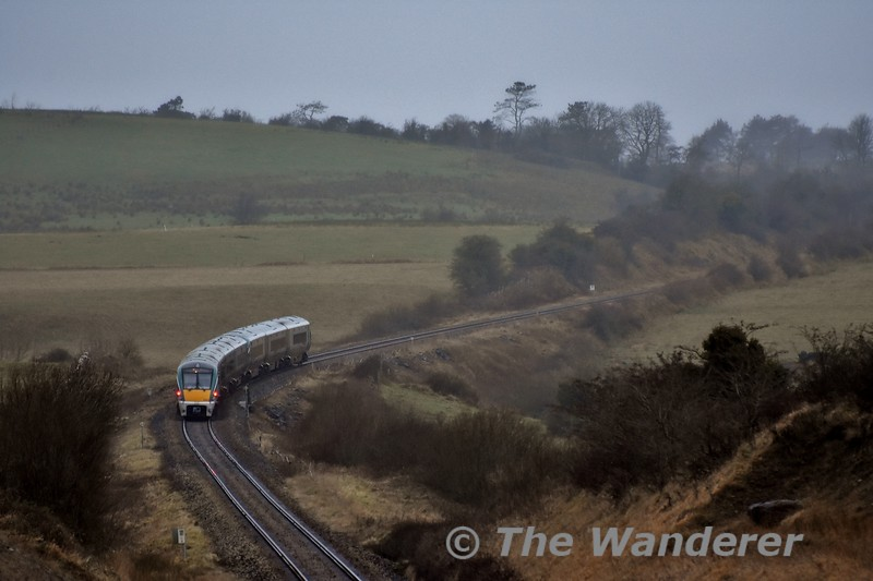 22049 + 22028 with the 1300 Connolly - Sligo passing Emlagh between Carrick-on-Shannon and Boyle . Sat 04.01.20